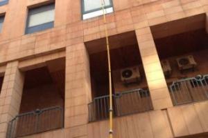Lavage vitre grande hauteur